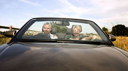 regard: Middle age couple in convertible car LANG_EVOIMAGES