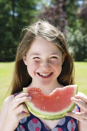 rejuvenated: Girl eating a watermelon LANG_EVOIMAGES