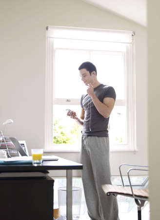 held down: Man with headphones in home office