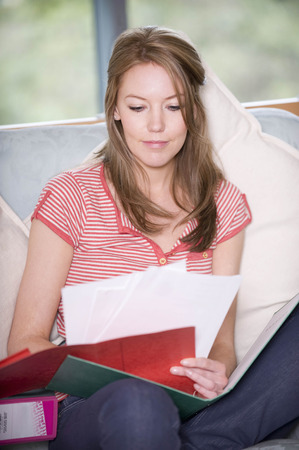 teleworking: A female checking some notes