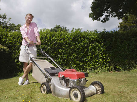 prideful: Man with push lawnmower