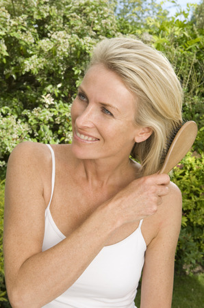 tetbury: Beauty portrait of woman brushing hair