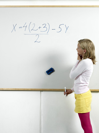 figuring: Girl standing by whiteboard