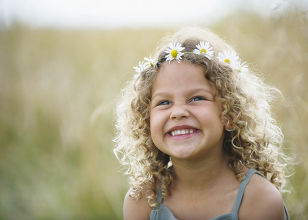 winchester: Young girl laughing with daisies in hair
