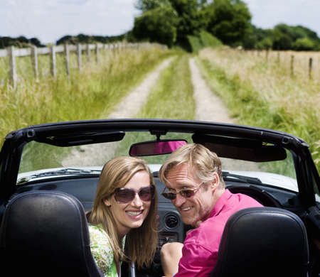 ceasing: Couple in convertible car