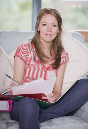 telecommuter: A female writing notes