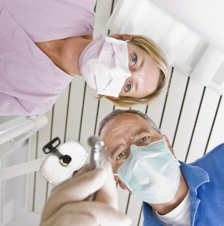 caregivers: Dentist and assistant using tools