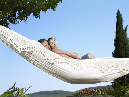 cuddled: Couple relaxing on hammock
