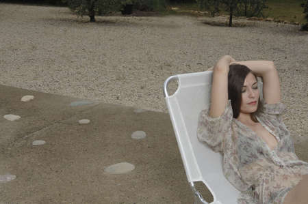 exhaustion: Woman relaxing on long chair