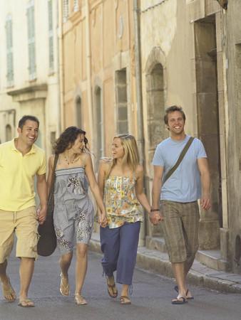 sidewalk talk: Friends walking along street