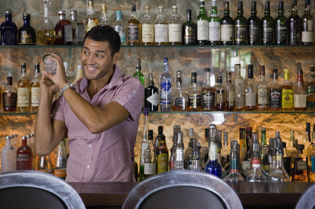 prideful: Male bartender mixing drinks