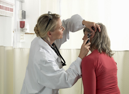 peep: Doctor examining mature woman