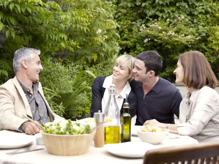 poppa: Family sitting having lunch in garden