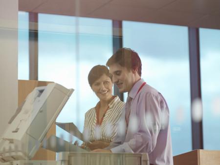 Man and woman at photocopier