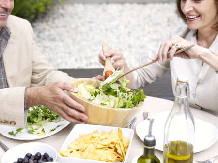 new age: Couple having lunch in garden LANG_EVOIMAGES