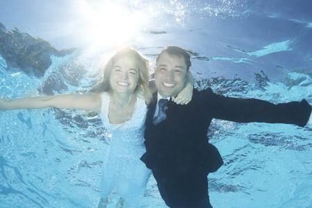 honeymooner: Bride and groom underwater