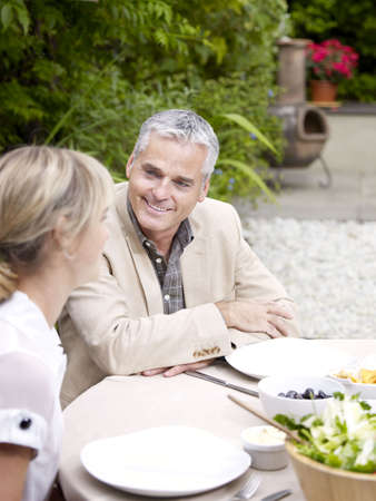 poppa: Man and woman sitting outside in garden