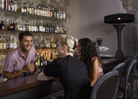 Male bartender taking customers orders
