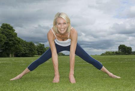 tetbury: Smiling woman in park exercising
