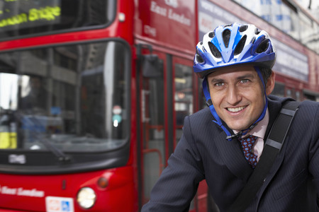 adventuring: Business man on a bicycle LANG_EVOIMAGES