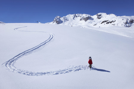 winter escape: Little girl skiing on mountain LANG_EVOIMAGES