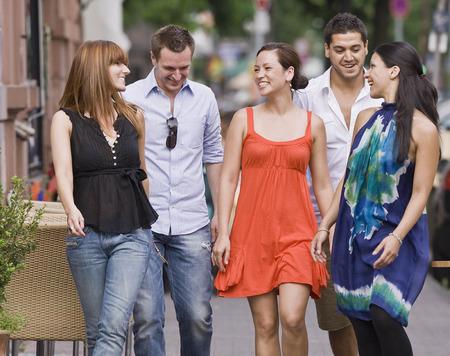 Group of friends walking down street