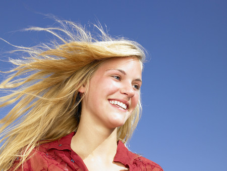 low spirited: Girl smiling,  wind in her hair