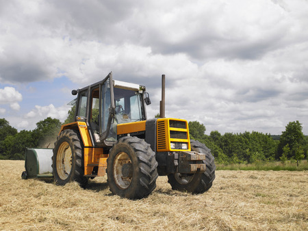 man driving tractor LANG_EVOIMAGES