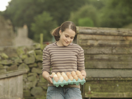 accomplishes: Girl With A Tray Of Eggs LANG_EVOIMAGES