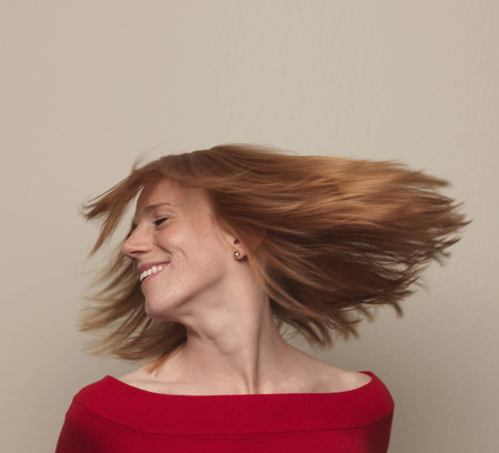 revolved: Woman spinning head around,  hair flying