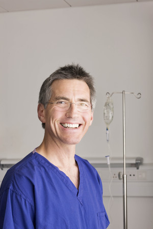 surgical gown: A doctor smiling to camera