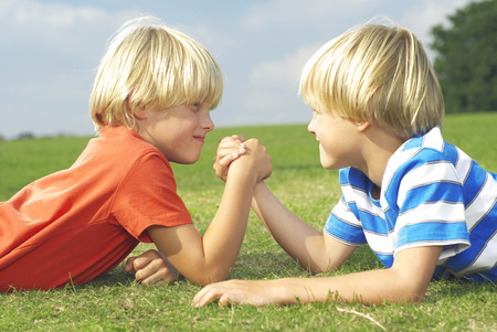 confrontational: two boys arm wrestling
