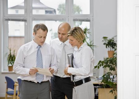 interrogations: Coworkers looking over paper work