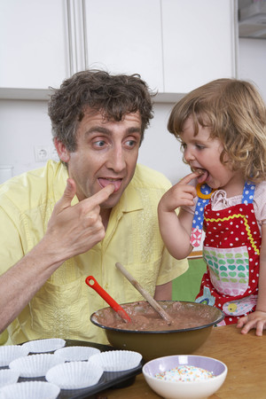 made in germany: Father and daughter, tasting batter