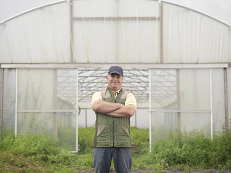 conservatories: Farmer Standing Outside Polytunnel