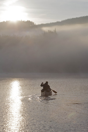 Kayaking in the morning mist. LANG_EVOIMAGES