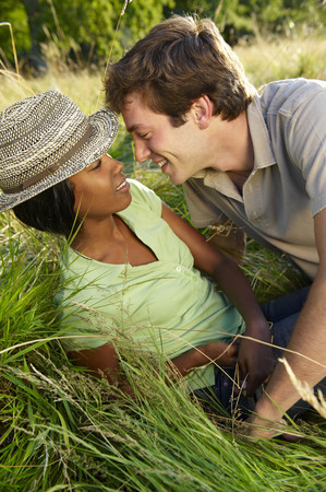 french ethnicity: Couple kissing in a field