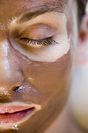dirtied: Woman with face mask on