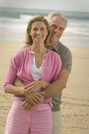 passions: Couple embracing on a beach