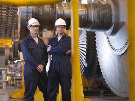 concluding: Engineers Next To Turbines