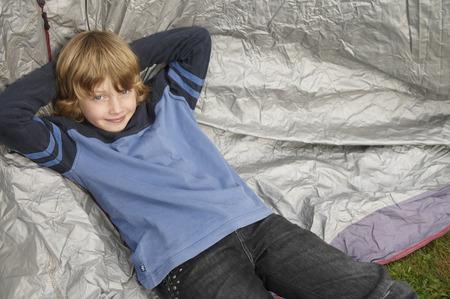 adventuresome: Boy resting on tent