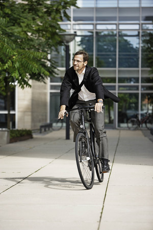 guides: Man leaving the office on bicycle
