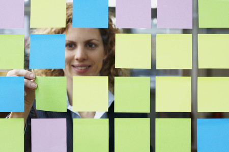 notations: Glass full of coloured sticky notes