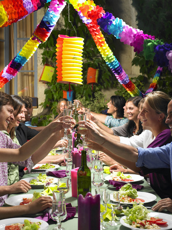 People sitting at table,  celebrating LANG_EVOIMAGES