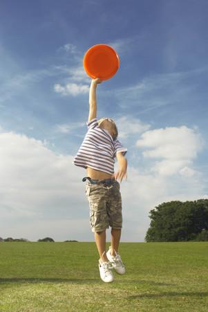boy catching frisbee