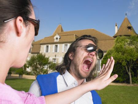 Woman slapping man