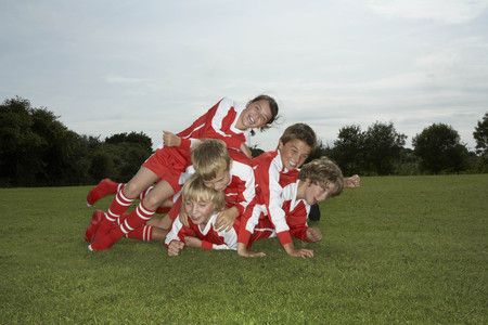 mischeif: Group of young footballers playing