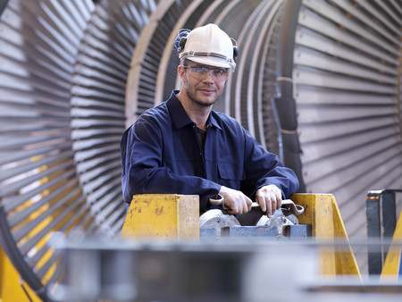 Engineer In Front Of Turbine