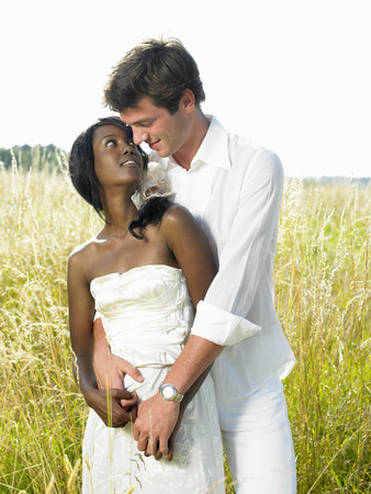 marrying: Married couple in a field LANG_EVOIMAGES