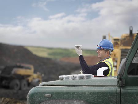 mined: Ecologist Inspecting Soil Samples LANG_EVOIMAGES